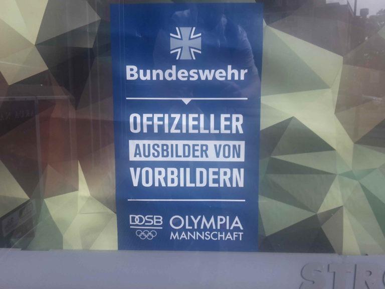 "Protest gegen Olympia-""Militärfestspiele"""
